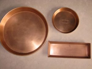 Guy has these copper drip pans made in India.