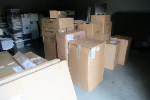 A shipment of products arrived from Grandinroad and the boxes were put in the garage of the gym building, awaiting to be unpacked.