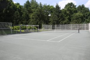 The tennis court sits at the far end of the property.