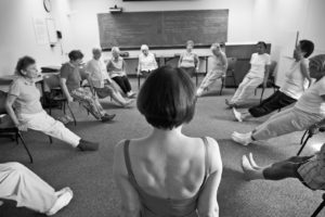 Deborah Quilter leads a chair yoga class