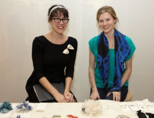 Corinne Gill and Blake Ramsey of Handle & Spout sell handmade silk flower hair accessories and leather jewelry.