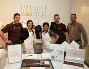 Chad Wagenheim (on left) & his retail staff, sold Martha Stewart Crafts products, as well as aprons, T-shirts, and a custom-made 'Ford Warriors in Pink' stamp kit.