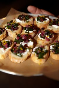 In addition to pizza, the menu also features 'toasts.'  Here is a tray of toasts topped with Swiss chard and ricotta.