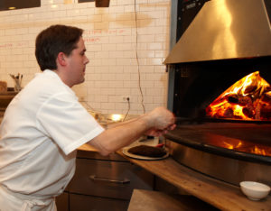 The pizza chef busy at work
