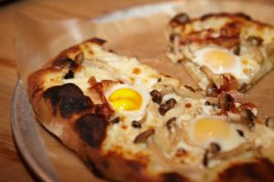 Pizza topped with quail eggs