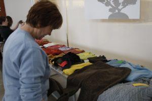 Helene is contemplating this pair of Donna Karan tweed slacks.