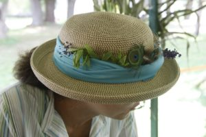 Lisa decorated her hat with herbal sprigs and flowers.