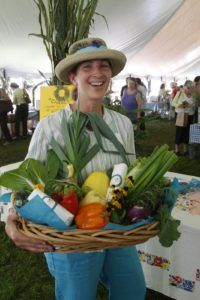 My friend, Lisa Schwartz of Rainbeau Ridge www.rainbeauridge.com, holding a basket of terrific produce and goat cheese from her farm for the fair's raffle.