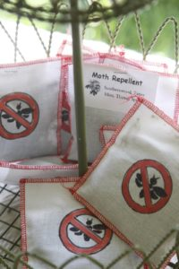 These cloth packets contain southernwood, tansy, mint, thyme, and spices - a natural moth repellent.
