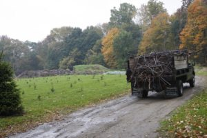 The truck is making its way to the far side of the property where the composting takes place.