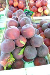 Fuzzy dark-skinned peaches