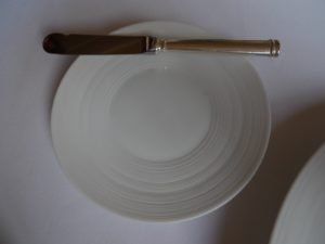 The cutlery, plates, and linens are simple, elegant, and appropriate for the fine food.