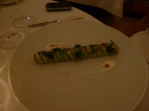 An avocado-wrapped roulade of prawns appetizer - so beautiful!