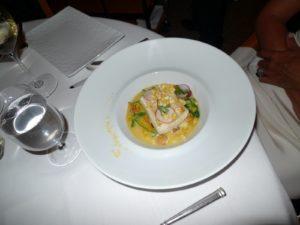 Poached cod with corn, radish, pea shoots, and purslane