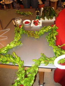 I demonstrated how to make a star wreath covered with boxwood and decorated with jingle bells.