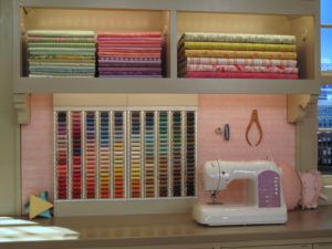 One of the sewing areas on the set of my show - I love the thread rack.
