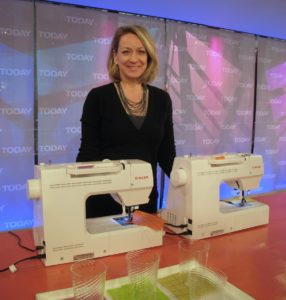 Here is Becky with the two machines we used to embroider coasters.