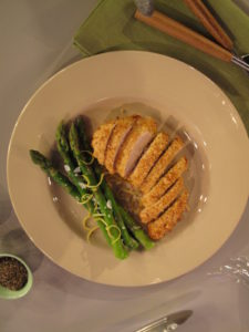 Delicious peanut-crusted chicken breast served with lemon-zested asparagus