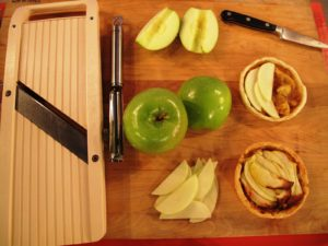 These are the ingredients for Roasted-Apple Tartlets.  A mandolin creates perfect thinly sliced apples.