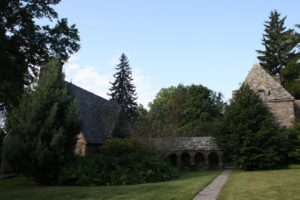 The architecture was designed to look ancient.  The stones of the building are Wissahickon Schist, which is in short supply today and was often quarried on site, while digging the foundations.  The roof is made of slate.