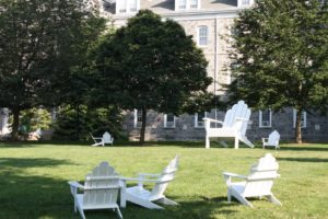 Adirondack chairs casually placed on the lawn - notice anything funny?