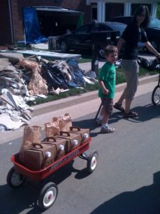 Little Parker helped by delivering coffee and bagels.