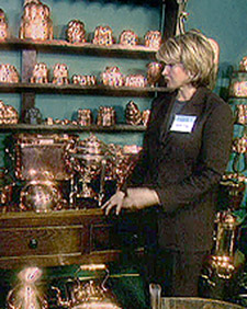 Visiting the Eve Stone Antiques booth at the Armory Antiques Show, in New York, and chatting with Eve's daughter Susan about copper molds. (OAD: 8/6/1998)