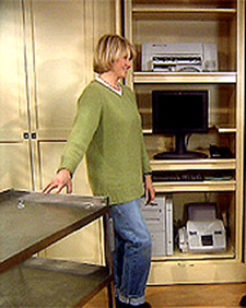 Carpenter Jim Cummings and I show how to convert a closet into an office/work space. (OAD: 1/21/1999)