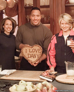 Here I am with Dwayne 'The Rock' Johnson making a heart-shaped chocolate chip cookie for his then-wife Dany. (OAD: 2/10/2000)