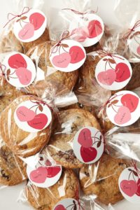 And last, but not least, is 'Make and Give.'  These beautifully packaged Valentine gifts are chocolate chunk-cherry cookies.  You can make the lovely cherry tag labels using clip art from marthastewart.com.