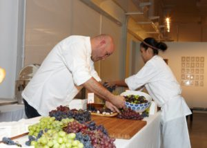 Pierre and Marianne prepare the buffet tables.