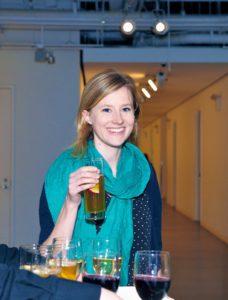 Blake Ramsey smiles with her Cider Smash