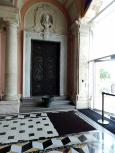 This is one of four 19th century doors and door surrounds from the demolished Torlonia Palace in Rome, located in the East Loggia.