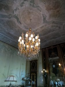 A giltwood and glass chandelier hangs in the first floor Reception Room.