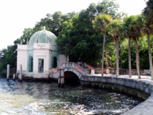 The estate's waterfront includes a Venetian bridge and a lattice-domed Tea House with mangrove beyond.