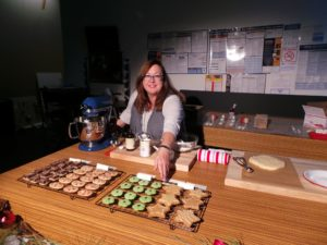 This is Kim Hartman, a food stylist, who did the baking for the  cookie segment. Here you can see pistachio spritz cookies,  chocolate-hazelnut shortbread squares, cinnamon-almond stars, and raspberry palmiers. All the recipes appear in our holiday cookie story in the December 2014/January 2015 issue, available on newsstands now.