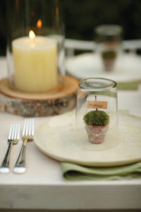 Our Good Things section gives great ideas for bringing spring to the table, like this place card, made from a little pot of moss….