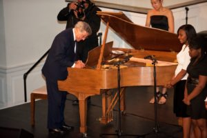 Honoree Tony Bennett autographing the 2010 Sing for Hope Steinway for auction.  The auction winner also receives the gift of a private piano debut, performed by Sing for Hope Donor Artists. Photo credit - Sing for Hope Donor Artist Nan Melville