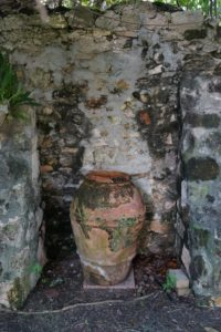 A great old terracotta urn is still in place in this alcove.