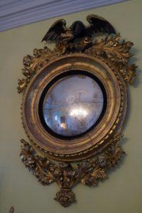 This fabulous girandole mirror, c. 1820, is similar to one that I own.