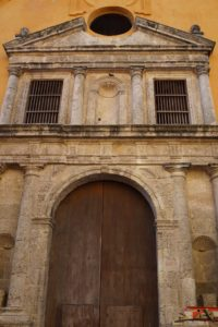 This is a Colonial doorway, typical of many homes in the old city of Cartagena.  Much of the stonework was carved from coral stone.