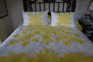 Beautiful handmade Hawaiian quilts grace some of the beds.