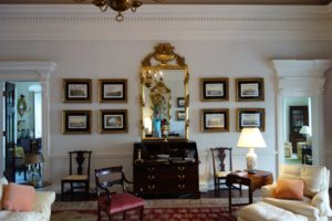Here we are in the Drawing Room with a gorgeous Boscobel gilt mirror, a handsome mahogany desk, and 8 out of 20 hand-colored lithographs of St. Petersburg, Russia in 1820.