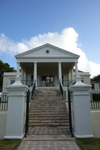 Here we are standing at the front façade of Cane Garden with its prominent Doric columns, which proclaim its classicism.