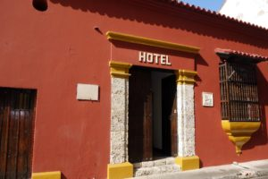 I love the terracotta color of this hotel, the coral stone entrance, and the bright ocher contrasting paint.