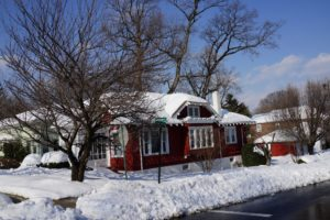 Across the street is a charming shingle cottage now painted red.  I remember it as a mossy green shade.