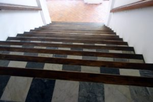 This is a black and white marble and mahogany staircase, which is steep and quite handsome.