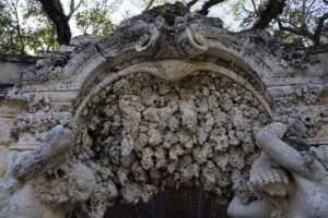 This is the rusticated entrance to one of a pair of grottos with carvings by Edoardo Cammilli.