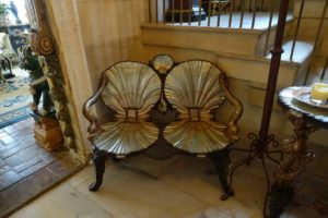 Also located in the foyer is this grotto settee, which John purchased. It is part of a set that also includes a chair. The settee was featured in a book by well-known English furniture maker, David Linley.
