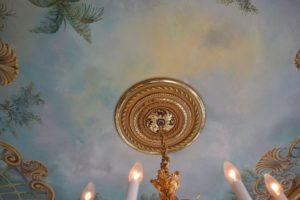In the same room, this marbleized finished ceiling was first done on canvas on the floor, and then painted and hung on the ceiling. The medallion surrounding the light fixture was also designed and installed by John.